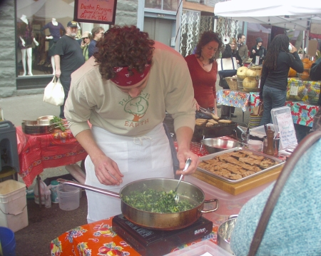 Chef Dustin Ronspies, owner of Wallingford's Art of the Table, cooking up a storm during the market's Eat Local for Thanksgiving campaign, November 2008. Photo copyright 2008 by Zachary D. Lyons