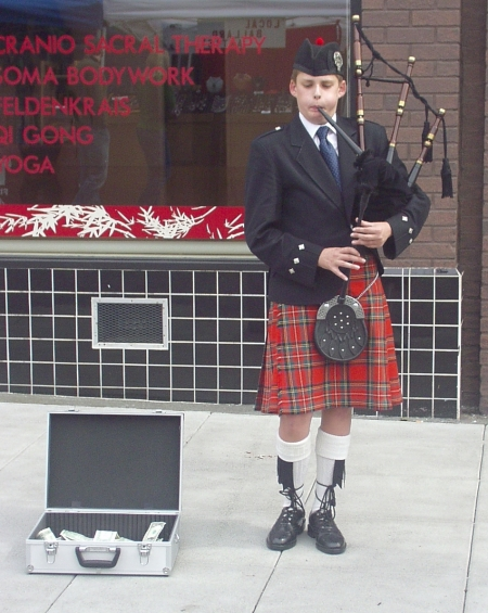 Joseph Steward playing the bagpipes at the Market on April 19th. Photo copyright 2009 by Zachary D. Lyons.