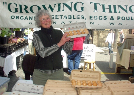 Michaele Blakely of Growing Things showing off her prized eggs. Photo copyright 2009 by Zachary D. Lyons.