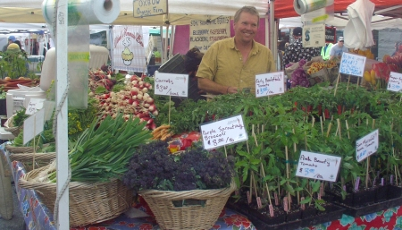 Ballard Farmers Market rejoices at the return of the smile face of Oxbow Farm's Luke Woodward. Photo copyright 2009 by Zachary D. Lyons.
