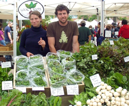 Siri and Jason of Local Roots Farm at Ballard Farmers Market on June 14th. Photo copyright 2009 by Zachary D. Lyons.