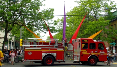One of Seattle's newest fire trucks, at only six weeks of age, sprouts Ballard Farmers Market flags on May 31st. Photo copyright 2009 by Zachary D. Lyons.