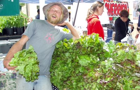 Okay. Look at the lettuce, not the sexy farmer! Photo copyright 2009 by Zachary D. Lyons.