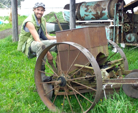 Jessie Hopkins from Colinwood Farms sits atop the farm's antique, horse-draw potato planter. Photo copyright 2010 by Zachary D. Lyons.