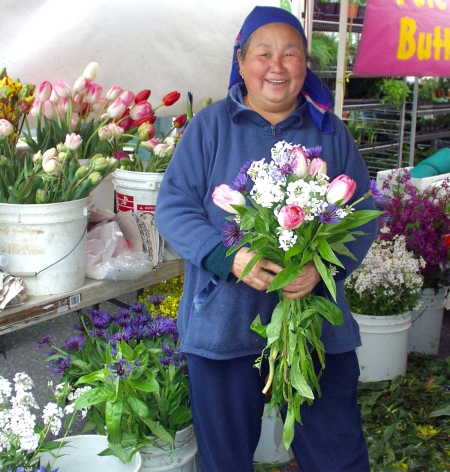 KaYing, The Old Farmer, arranging one of her beautiful bouquets of flowers. Photo copyright 2010 by Zachary D. Lyons.