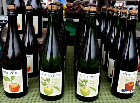 Bottle-fermented hard ciders from Finnriver Farm & Cidery at Ballard Farmers Market. Copyright Zachary D. Lyons.