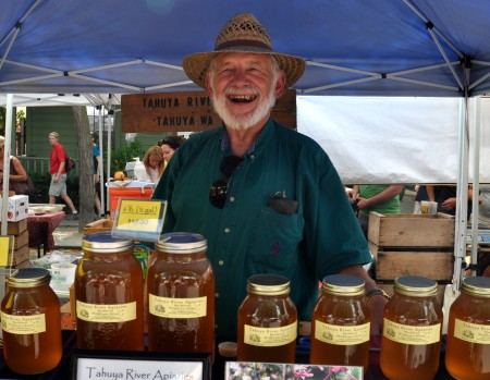 Roy Nettlebeck, owner of Tahuya River Apiaries, has something sweet to smile about -- honey! Photo copyright 2011 by Zachary D. Lyons.