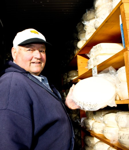 Victor Jensen in the aging room at Golden Glen Creamery. Photo copyright by Mandy Alderink, courtesy of Golden Glen Creamery.