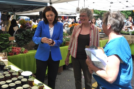Michaele Blakely from Growing Things Farm (center) with U.S. Senator Maria Cantwell (left) and Market Master Judy Kirkhuff at Ballard Farmers Market last summer. Photo copyright 2012 by Zachary D. Lyons.