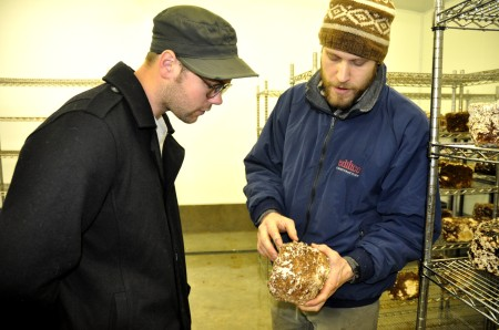 Will Lockmiller of Sno-Valley Mushrooms explaining the process to our own Gil Youenes. Photo copyright 2012 by Zachary D. Lyons.