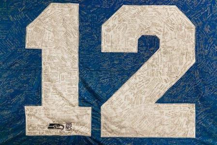 Signed 12th Man flag. Photo courtesy Seattle Seahawks.