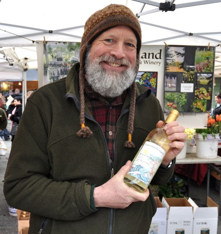 Brent Charnley, winemaker at Lopez Island Vineyards, hold the new release of his Wave Crest White table wine. Photo copyright 2013 by Zachary D. Lyons.