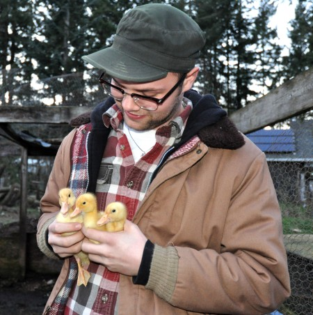 Gil holds ducklings at Stokesberry Sustainable Farm. Photo copyright 2013 by Zachary D. Lyons.