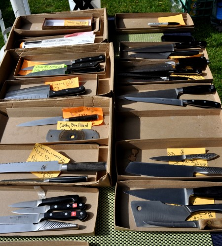 Knives lined up for sharpening at Your Knife Sharpening Guy. Photo copyright 2013 by Zachary D. Lyons.
