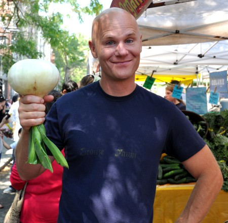 Jim holds a gigantic sweet onion from Nash's Organic Produce. Photo copyright 2013 by Zachary D. Lyons.