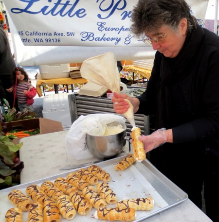 Marie Makovicka of Little Prague European Bakery piping fresh cannoli. Photo copyright 2013 by Ben Chandler.