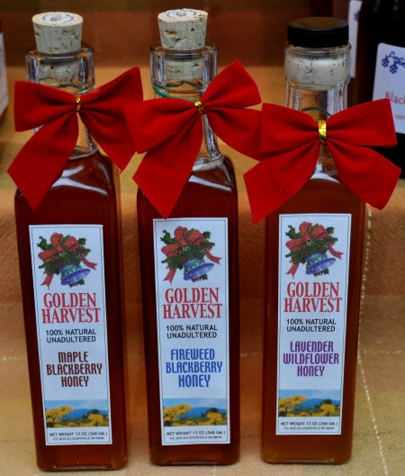 Festive holiday bottles of honey from Golden Harvest Bee Ranch. Photo copyright 2013 by Zachary D. Lyons.