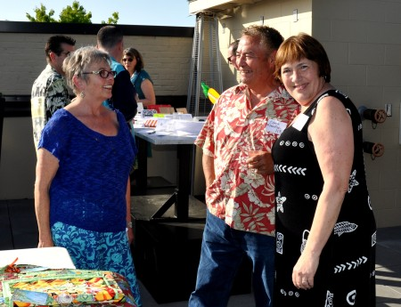Our Market Master, Judy Kirkhuff, with Gene & Jania of Wilson Fish at our May Fresh Bucks fundraiser. Copyright Zachary D. Lyons.