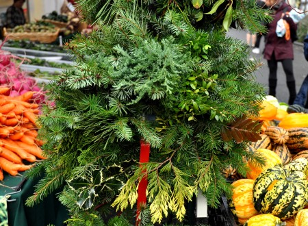 Fresh holiday wreaths from Alm Hill Gardens (Growing Washington) at Ballard Farmers Market. Copyright Zachary D. Lyons.