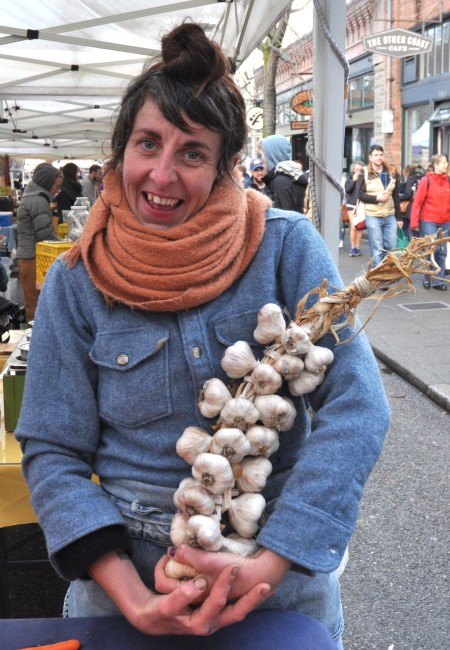 Carolina models a beautiful garlic braid from Kirsop Farm at Ballard Farmers Market. Copyright Zachary D. Lyons.