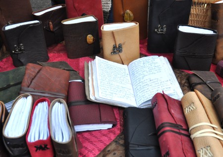 Handmade leather bound journals from No Boundaries at Ballard Farmers Market. Copyright Zachary D. Lyons.